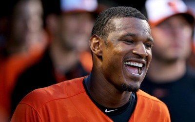BALTIMORE, MD - JUNE 29: Center fielder Adam Jones #10 of the Baltimore Orioles celebrates after teammate Ryan Flaherty's (not pictured) three home run in the third inning against the New York Yankees at Oriole Park at Camden Yards on June 29, 2013 in Baltimore, Maryland. (Photo by Patrick Smith/Getty Images)